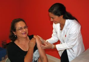 walgreens-pharmacist-angela-nikitas-gives-a-flu-shot-at-the-bob-macauley-americares-free-clinic-in-norwalk-photo-courtesy-of-americares